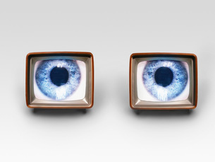Two television sets with eyes on screens digital compositeの写真素材 [FYI03638413]