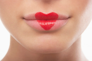 Lips painted with lipstick heartの写真素材 [FYI03638576]