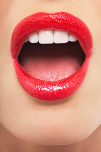 Surprised mouth with lipstickの写真素材 [FYI03638577]