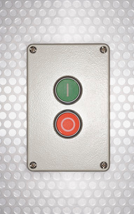 Red and green buttons on silver backgroundの写真素材 [FYI03638617]