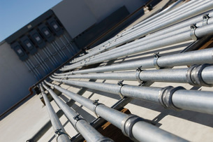 Pipes Leading to Electrical Boxes at Solar Power Plantの写真素材 [FYI03640193]