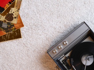 Record player and vinyl records on floor view from aboveの写真素材 [FYI03640224]