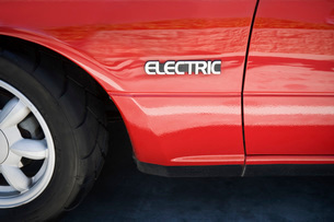 Close up of sign on electric carの写真素材 [FYI03640475]