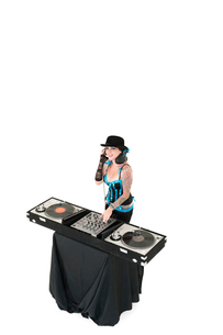 Portrait of young DJ with sound mixing equipment wearing hatの写真素材 [FYI03640791]