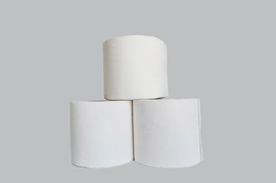 Stacks of rolls of toilet paper on white backgroundの写真素材 [FYI03640816]
