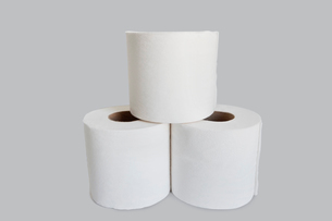 Close-up view of toilet paper stack on white backgroundの写真素材 [FYI03640821]