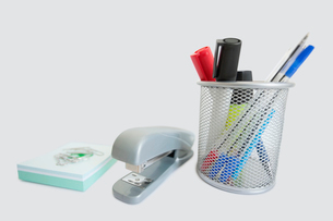 Close-up of office supplies over white backgroundの写真素材 [FYI03640831]