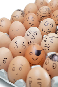 Various facial expressions painted on brown eggs arranged inの写真素材 [FYI03640872]