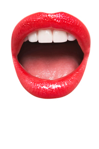 Close-up view of female wearing red lipstick with mouth openの写真素材 [FYI03640930]