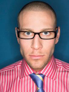 Man in glasses head and shoulders portraitの写真素材 [FYI03641079]