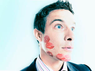 Businessman with lipstick kiss-marksの写真素材 [FYI03641217]