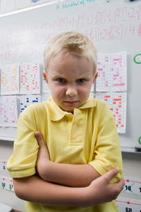 Angry Little Boy in a Classroomの写真素材 [FYI03641480]