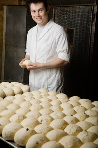 Baker With Balls of Bread Dough Ready to Bakeの写真素材 [FYI03641490]