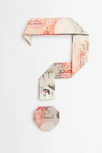 Question mark symbol made of folded banknotesの写真素材 [FYI03641508]