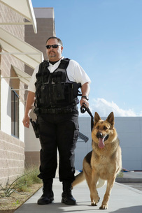 Security guard with dog on patrolの写真素材 [FYI03642638]