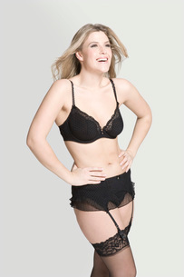 Sexy young woman in underwear laughingの写真素材 [FYI03642791]