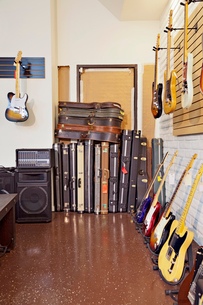 Electric guitars with guitar cases and amplifier in storeの写真素材 [FYI03642995]
