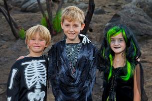 Portrait of three friends in Halloween costumeの写真素材 [FYI03643004]