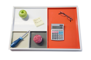 Tray with green apple, calculator, eyewear and other officeの写真素材 [FYI03643030]