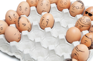 Variety of facial expressions painted on brown eggs arrangedの写真素材 [FYI03643123]