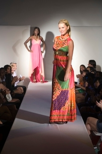 Woman in multicoloured dress on fashion catwalkの写真素材 [FYI03643233]