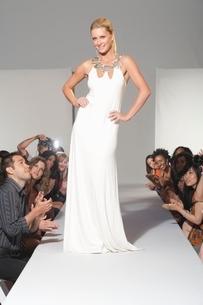 Woman stands in bridalwear on fashion catwalkの写真素材 [FYI03643236]