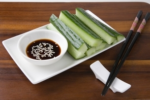 Soy sauce cucumber and sesame seeds with chopsticksの写真素材 [FYI03643334]