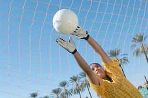 Girl Reaching for Soccer Ballの写真素材 [FYI03643506]