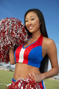 Cheerleader with pom pomsの写真素材 [FYI03643551]