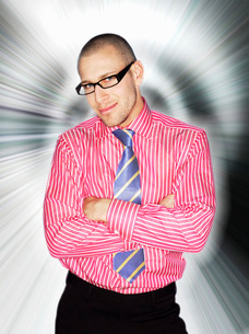 Business man in glasses smiling in front of light effectの写真素材 [FYI03643868]