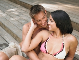 Affectionate Young Couple Relaxing on Terraceの写真素材 [FYI03644008]