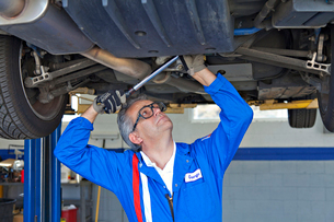 Mechanic repairing the car with a monkey wrenchの写真素材 [FYI03644663]