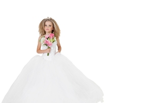 Girl in wedding dress holding flower bouquet while looking aの写真素材 [FYI03645100]