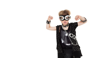 Front view of punk kid wearing pilot goggles with raised fisの写真素材 [FYI03645117]