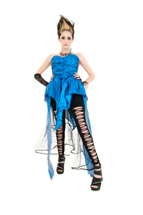 Beautiful young woman wearing ripped dress with spiked hairsの写真素材 [FYI03645146]