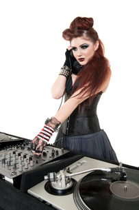 Beautiful DJ with sound mixing equipment over white backgrouの写真素材 [FYI03645154]