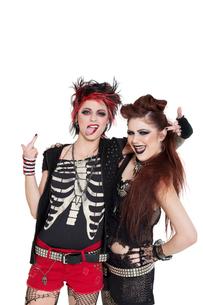 Arrogant punk females showing middle finger over white backgの写真素材 [FYI03645174]