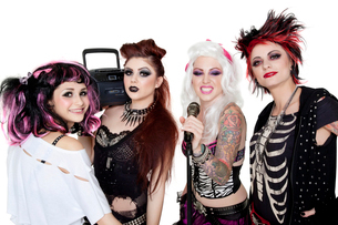 Portrait of all female band with microphone and boom box oveの写真素材 [FYI03645179]