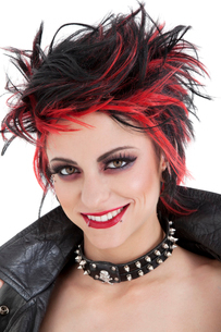 Portrait of beautiful young punk woman with spiked hairの写真素材 [FYI03645184]
