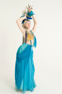 Attractive young woman wearing costume posing over colored bの写真素材 [FYI03645190]