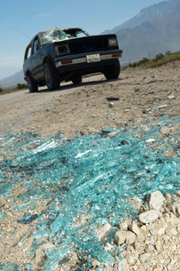 Close-up of broken windshield pieces on ground truck in backの写真素材 [FYI03645421]