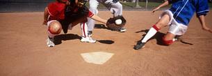 Girls (13-17) playing baseball low sectionの写真素材 [FYI03645580]