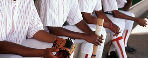 Baseball players sitting in dugoutの写真素材 [FYI03645593]