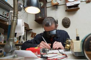 Clock Repairman at Workの写真素材 [FYI03645635]