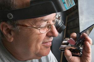 Clock Repairman at Workの写真素材 [FYI03645657]
