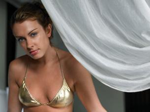 Young Woman in Bikini by Curtainの写真素材 [FYI03645746]
