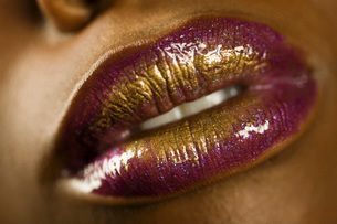 Young Woman with Purple and Gold Lipstickの写真素材 [FYI03645802]