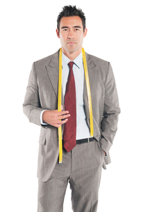 Portrait of handsome tailor standing over white backgroundの写真素材 [FYI03646037]