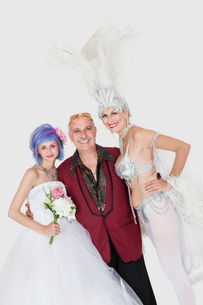 Portrait of man with senior showgirl and daughter in weddingの写真素材 [FYI03646274]