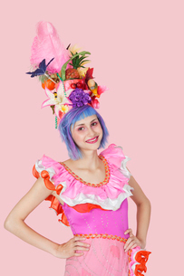 Portrait of beautiful young woman in Brazilian outfit over pの写真素材 [FYI03646297]
